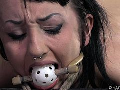 Naughty Bunny thought things can go her way so she ended up at Hard Tied. This cunt is now receiving the discipline she needs. She stays bent over tied up hard and ball gagged as the executor spanks her ass so hard that she almost cries. After he spanked it with a stick he grabs a paddle and hits that butt harder