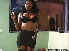 Hot ebony loves posing her sexy lingerie while smoking a cigarette