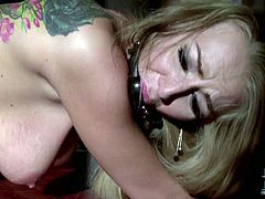 Tattooed blonde with gag in her mouth gets fucked mercilessly