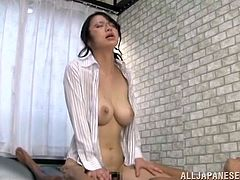 Miki Horiuchi the big breasted Japanese chick oils her boobs up and then rubs them against guy's chest. After that she gets fucked hard from behind.
