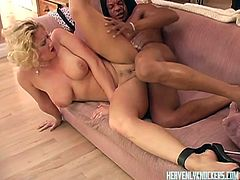 Busty blonde enjoys spreading for black hunk eager to pound her and make her moan