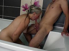 After years of not seeing one another, this homely grandmother welcomes her grown grandson with a very special bath in the jacuzzi. Both naked and wanting to reconnect once more, this mature woman led the way in sucking his grandson's dick which led to a fiery fucking from behind! Go grandma!