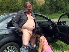 Insatiable daddy takes a filthy brunette whore in the field where she stands by the car with leg pulled up while welcoming a tongue fuck from him.