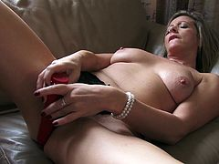This mature lady has is desperate to fill her pussy up. She is in her panties and entertaining her viewers by showing her appealing boobs and attractive body. She squeezes her nipples and boobs and the she pulls her panties up to rub her shaved cunt with that dildo. Is it lucky enough to go in there?