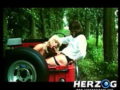 In this retro porn a romantic guy decides to take his lady for a nice ride into the woods in her jeep. When they arrive at a secluded location, she sucks on his cock with great pleasure. They return home and fuck some more.