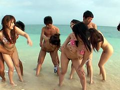 A bunch of guys is having fun on a public beach with dirty sluts Hina Maeda, Kyouko Maki and Yui Nanase. They poke them bad in a standing position.