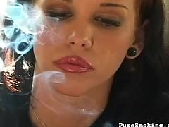 She is quite horny and teasing with her naughty smoking is surely making her hot