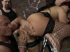 Super sexy black haired buxom slut in fishnet stockings gang banged by a group of bad boys