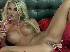With juicy melons and smooth beaver bares it all and masturbates in closeup
