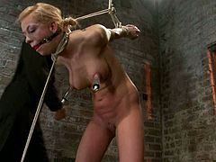 This blond honey is so kinky and charming. Her sex master could not stand the temptation and did what he loves doing most. Suspension and a spreader bar!