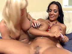Stunning blonde and black haired lesbian milfs Angie Savage and Nina Mercedez with huge jaw dropping gaozngas and bouncing asses pleasure each other with vibrators to loud wet orgasms.
