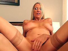 Smoking hot blonde milf Emma Starr with big fake hooters and slim sexy body in high heels only rides on young Johnny Castle with muscled body and gets rammed to orgasm.