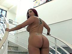 Fascinating redhead slut with long hair, plump ass, hot tattoos and huge tits Kelly Divine poses near the pool