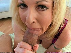 Gorgeous blonde MILF strips her clothes off and fondles her vagina in close-up scenes. After that she gives hot blowjob.