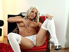 Solo blonde in white lingerie is sexy tease