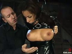 Trixie Cas is the naughty brunette getting her pussy fucked hard in this domination BDSM video with bondage action.