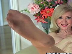 Blonde mature in sexy pantyhose likes to play nasty and masturbate her wet vag