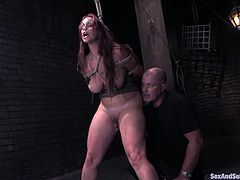 Tied up brunette girl gets her tits tortured with clothespins. After that she also gets her pussy fucked hard. In addition her master shoves a burning candle in her ass.