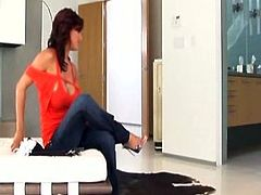 This Indian brunette is tired of homework. She gets rid of red top and jeans, sits onto the couch and stretches legs wide. Kinky wanker with big droopy boobs gets busy with tickling her wet pussy for orgasm.