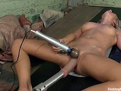 Sexy blonde girl spreads her legs and toys her shaved pussy with a vibrator. After that she also gets toyed by fucking machines.