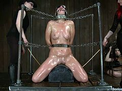 Blindfolded, tied in chains and with her sexy body oiled up Tara finds out how we like to treat our ladies here at Device Bondage. She's a beautiful whore that deserves our special attention so the mistresses begin they work by spanking her and making sure that pussy is well positioned over the rodeo sex machine