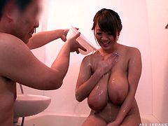 Hot Japanese milf Hitomi Tanaka is playing wet games with her man in the shower. She lets the dude soap and squeeze her massive boobs and then kneels in front of him and drives him crazy with a terrific titjob.