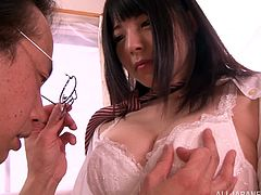 Lewd Japanese chick Ai Uehara shows her snatch to an older man and lets him examine it. Then she sits down on his prick and they have sex in cowgirl position.
