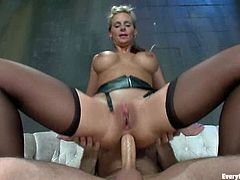 Busty blonde milf Phoenix Marie is having fun with some guy in a basement. The man toys and fists Marie's ass and then drills it hard from behind.