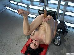 Sexy tattooed brunette Veruca James is having some good time indoors. She strokes her beautiful body and then gets her vag drilled remarcably well by a fucking machine.