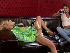 Sextractive blond chic moans with pleasure while rapacious brunette domina tickles her soaking vagina with vibrator while taping her on cam in steamy lesbian sex video by Tainster.