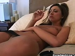 Stunning beauty loves posing her sexy pantyhose while smoking and getting horny