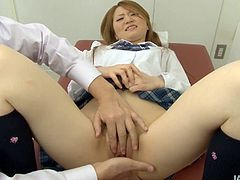 Naive looking Japanese student in college uniform gets her unused pinkish vagina finger fucked in close up sex scene as she lies on the desk in front of her teacher.