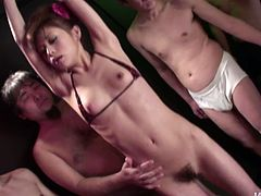 Slender Japanese hoe with small perky tits covered with tiny bikini gets aroused with numerous vibrators before she welcomes two sturdy cocks in her mouth for blowjob.
