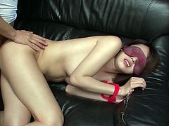 Blindfolded Asian whore with nice round tits gives hot blowjob to her horny friend and then she spreads her legs wide and lets him drill her hairy snatch in missionary position.