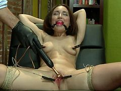 She has a sweet, tight cunt, freshly shaved and perfect to play with. This chick has been tied on that chair, ball gagged so she won't scream and her thighs are wide spread. The guy used laundry pliers to gape her small pussy and now starts to play with it. This is only for the warm up so stick around and see more