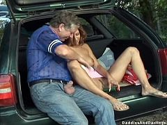 Watch this hardcore video where a horny teen brunette is fucked by an old man in the back of his family car.