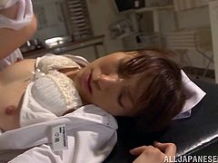 Kinky Japanese nurse is playing dirty games with some dude. She rubs and sucks his manhood and then welcomes it in her juicy throbbing snatch.