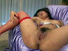 Fuckable Japanese milf in red fishnet stockings gets her soaking wet vagina pounded with dildo while getting her clit teased with vibrator in steamy sex video by Jav HD.