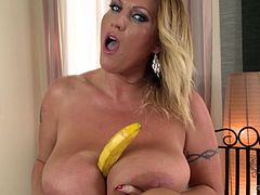 Extremely curvy BBW mommy with massive hooters pets her bald cunt with vibrator. She rubs her fun bags all over the glass table and squeezes banana between her juggs.