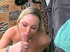 Pretty long haired blonde milf Abbey Brookes with delicious round ass and big fake hooters in lingerie gets licked by her neighbor and gives him memorable blowjob in living room.