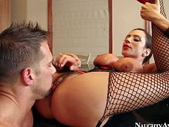 Nasty dark haired and busty pornstar Ariella Ferrera in leather corset enjoys in a passionate pussy licking and cock riding actions on the bed with her lover Johnny Castle