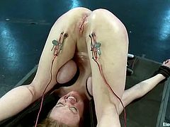 Darling and Lorelei Lee are having some good time together. Lorelei binds the girl, attaches wires to her legs and then smashes her pussy with a dildo.