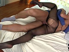 Perfect brunette with small tits rides her man on top. She haas a hole in her pantyhose and the dicks goes in right there!