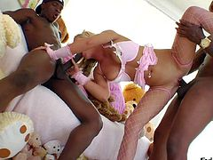 Blonde bitch Andi Anderson in pink fishnet stockings has a nice time with two well hung black dudes. She rides one big black dick and gives head to another guy at the same time.