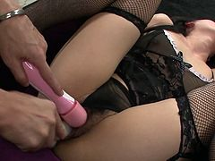 Hot blooded Japanese hoe in seductive black lingerie and fishnet stockings gets aroused with intensive tickling of her vagina with vibrator before she kneels down to give numerous blowjob in gangbang sex clip by Jav HD.