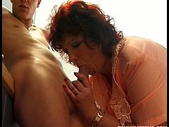 Frizzy ugly housewife Corrie takes a chance to suck the stud's dick for cum
