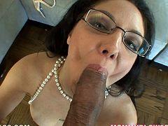 This juicy milf in glasses is charming with her luxury! She gets on that cock and starts rubbing it in between her juicy boobs. She is so damn sexy!