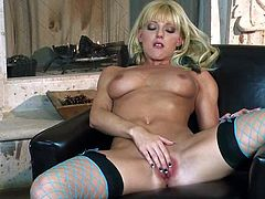 Charing blonde Niki Young in stockings and high heels spreads her legs by the fireplace and polishes her pink pussy. She slides her fingers inside her wet tight hole. Watch Niki Young play with her twat.