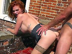 Cock addicted redhead cougar Tarra White with big juicy tits and hot body in stockings gives head to Jay Snake with huge back tattoo and gets rammed to orgasm in backyard.