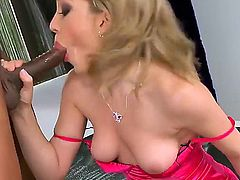 Slutty and pale hot blonde honey Lily LaBeau enjoys in sucking a hard black bazooka on her knees and gets fingered and rammed by her black lover as well